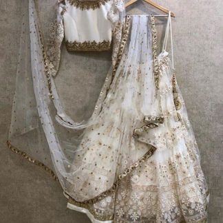 Beauteous Off White Colored Tissue With Embroidered Work Lehenga Choli