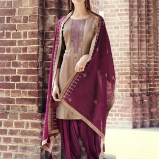 Bewitching Maroon Rayon With Embroidered Work Punjabi suit design