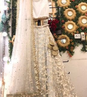 Lovely Cream Colored Silk With Embroidered Work Lehenga Choli Design Online