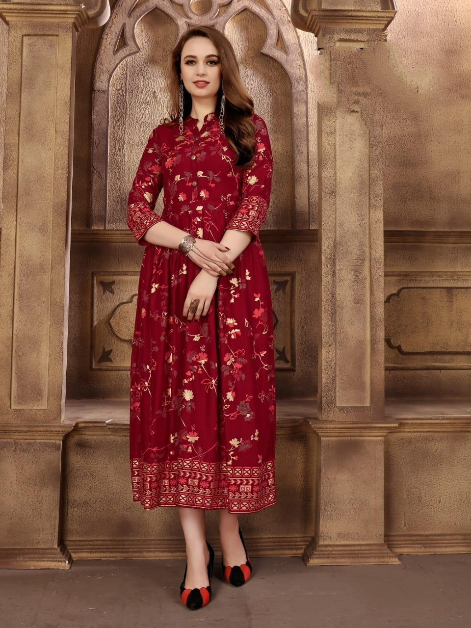 Glorious Maroon Rayon Foil Printed Party Wear Gown