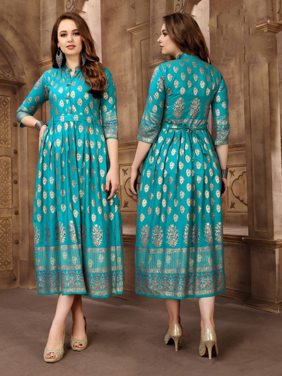 Exquisite Firozi Rayon Foil Printed Gown